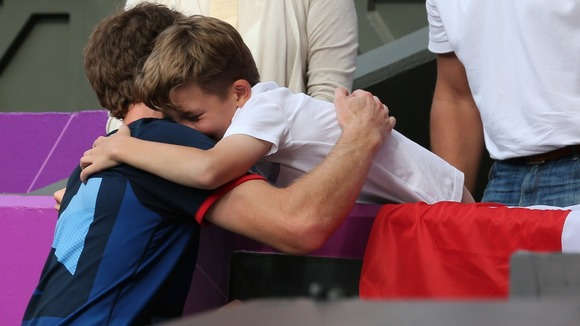 Aaah moment of the Olympics so far: Olympic Champion Andy Murray hugs young fan Henry Caplan.