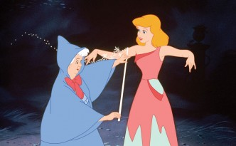Cinderella is measured for a ballgown by her Fairy Godmother in a scene from Disney's Cinderella.
