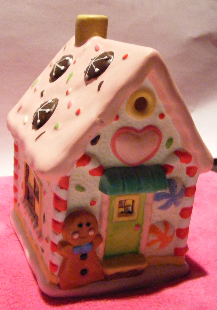 China Gingerbread House, decorated with sweets, a heart over the frontdoor and a resident Gingerbread Man.