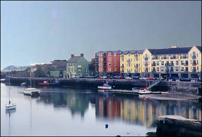 Brightly coloured buildings overlook Dungarvan harbour and are reflected in its welcoming water.  I'm getting creative already!