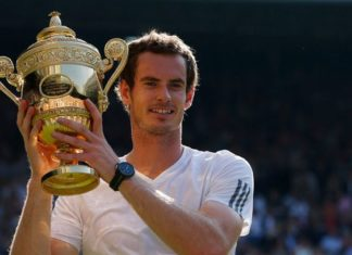 Andy Murray lifts the Wimbledon Trophy after his dramatic triumph in the Men's Singles 2013
