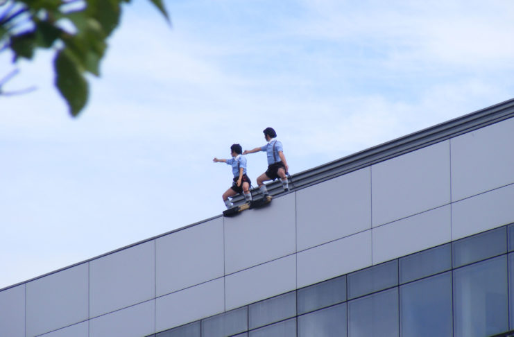 Spanish dance company Delreves, performing the opening moves of their Alice in Wonderland Inspired routine: 'Repite Conmigo' begin their dance at the top of the Menapia Building.