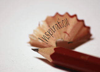 Pencil and pencil shaving, depicting the word 'inspiration'.