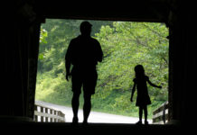 Father and daughter in silhouette