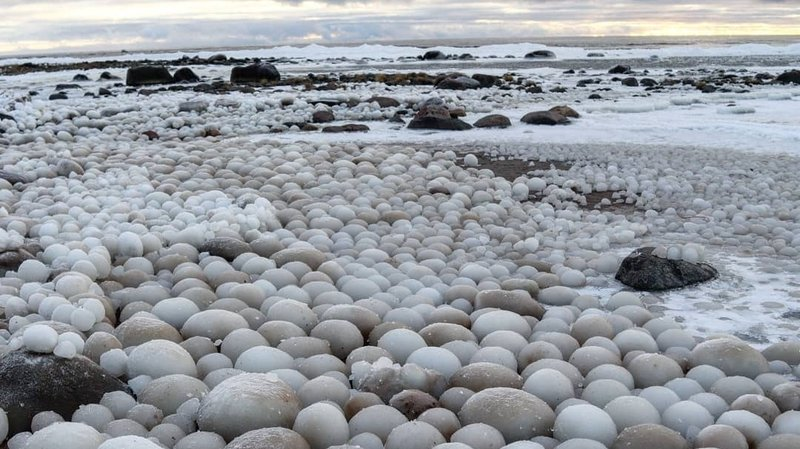 Ice balls piling up on a Finnish beach